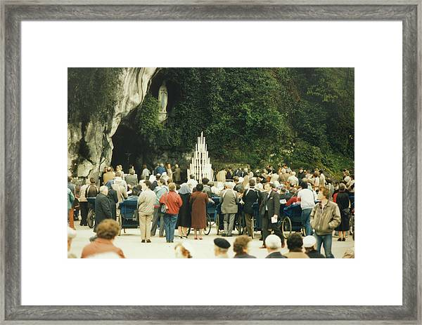 Pilgrims Gather At The Grotto  Where Framed Print