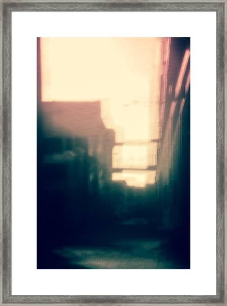 Pinholed Cityscape  Framed Print