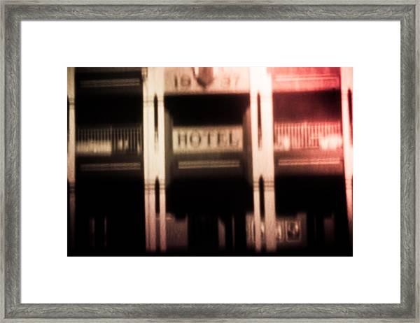 Pinholed Hotel  Framed Print