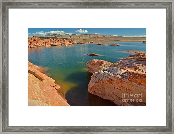 Pink Rocks Blue Water Framed Print