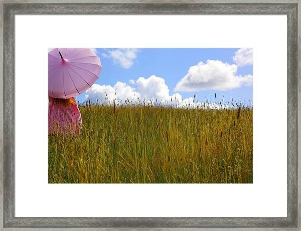 Pink Umbrella In The Meadow Framed Print