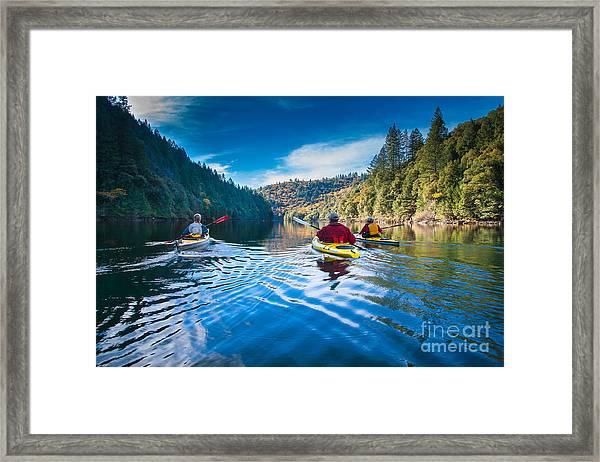 Placid Paddle Framed Print