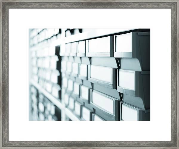 Plastic Boxes Framed Print