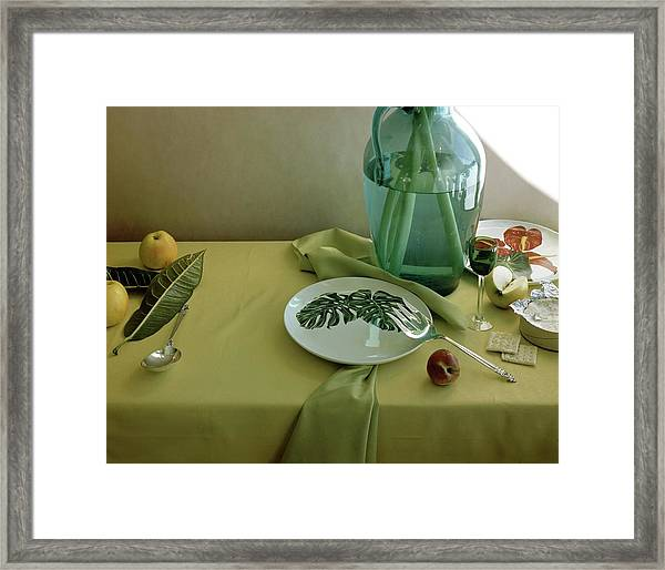 Plates, Apples And A Vase On A Green Tablecloth Framed Print