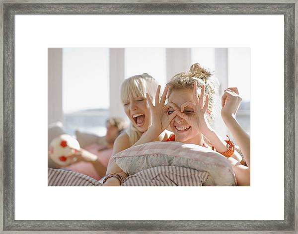 Playful Women Making Faces Framed Print by Paul Bradbury