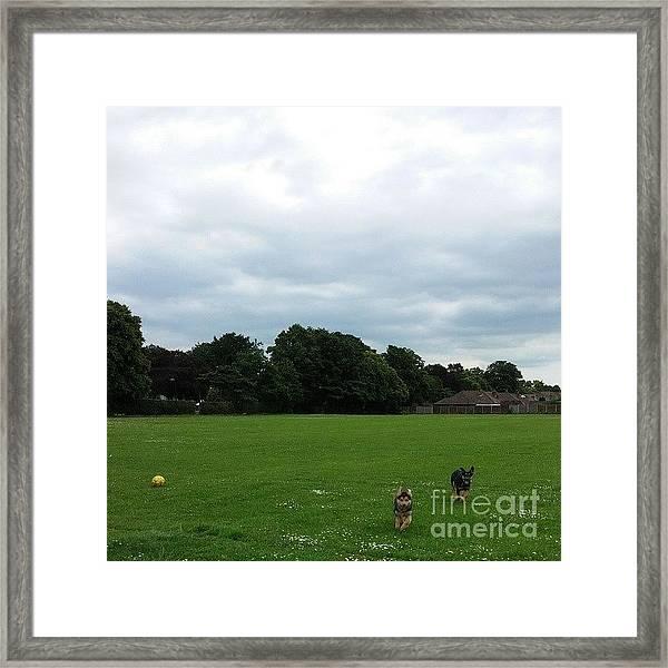 Playing Football Framed Print