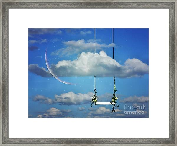 Playing In The Clouds Framed Print