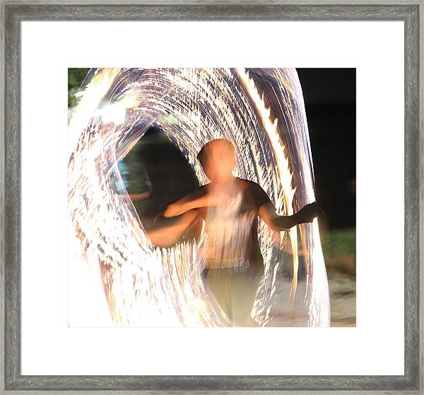 Framed Print featuring the photograph playing with Fire by Debbie Cundy