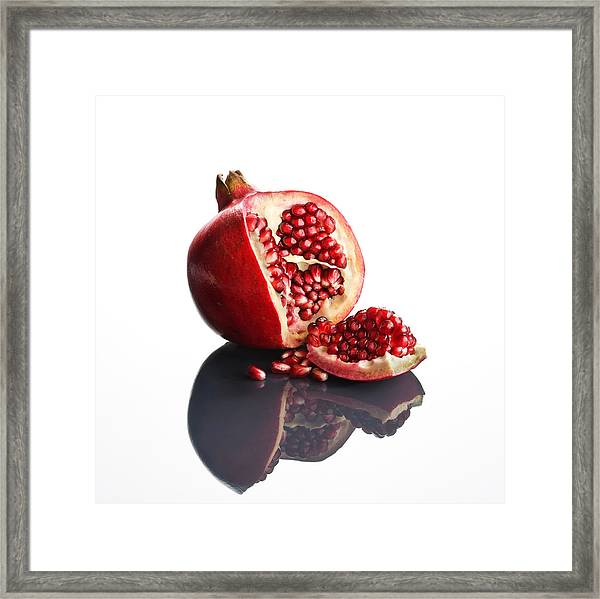 Pomegranate Opened Up On Reflective Surface Framed Print