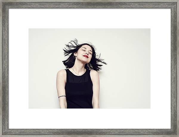 Portrait Of A Carefree Young Woman Framed Print by Flashpop