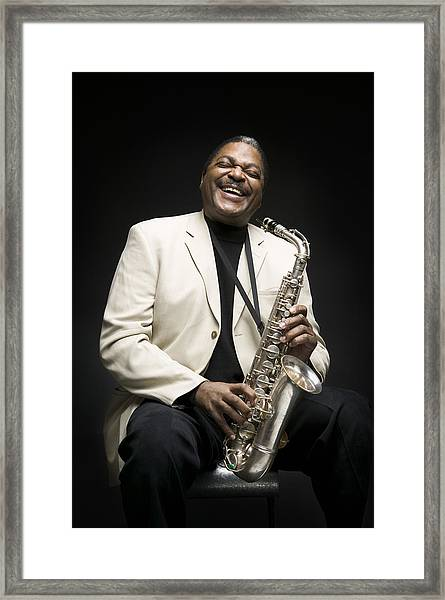 Portrait Of A Man Holding A Saxophone Framed Print by Photodisc