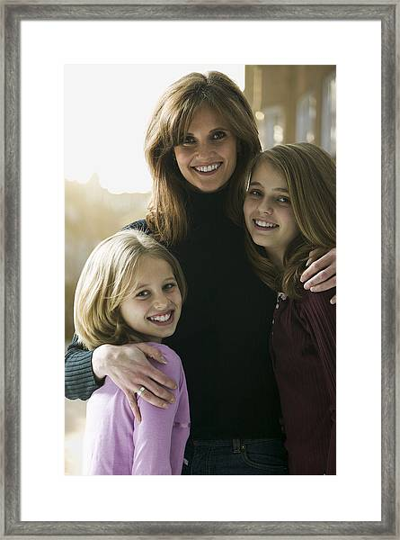 Portrait Of A Mid Adult Woman With Her Daughters Framed Print by Photodisc