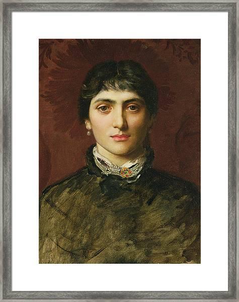 Portrait Of A Woman With Dark Hair Framed Print