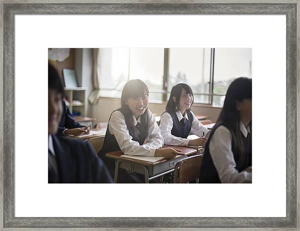 Portrait Of Happy High School Girls In Classroom Framed Print by Xavier Arnau