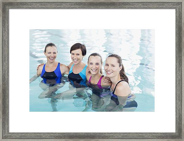 Portrait Of Smiling Women In Swimming Pool Framed Print by Robert Daly
