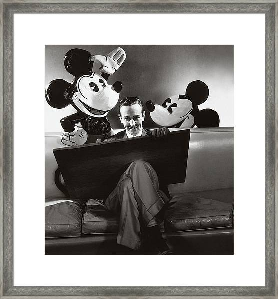 Portrait Of Walt Disney Sitting With Open Cartoon Framed Print by Edward Steichen