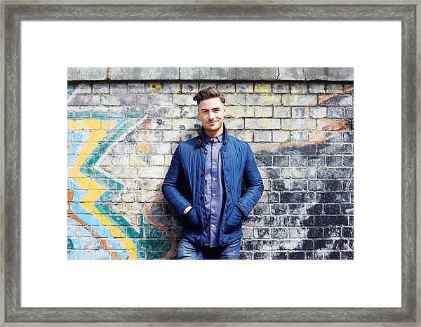 Portrait Of Young Man Against Wall. Framed Print by Tim Robberts