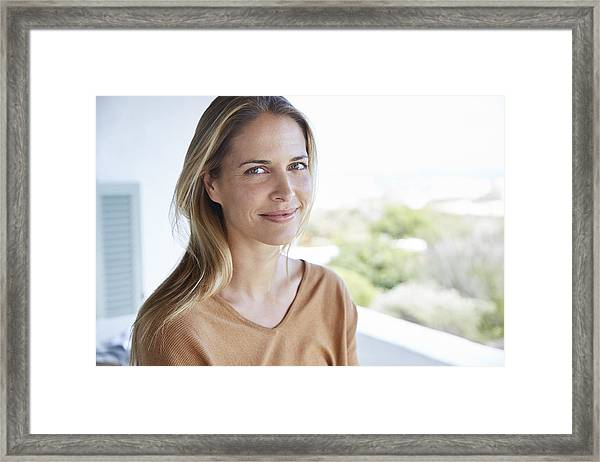 Portrait Smiling Blonde Woman On Patio Framed Print by Hoxton/Ryan Lees