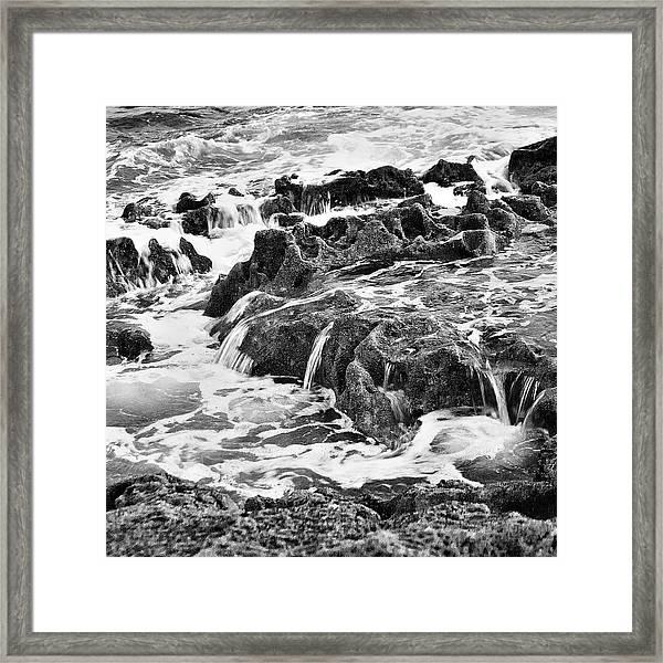 Pouring Rocks Framed Print