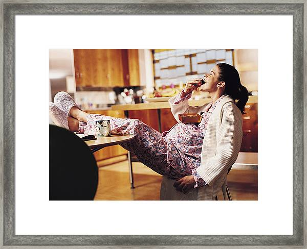 Pregnant Woman Eating Chocolate Framed Print by Cohen/Ostrow