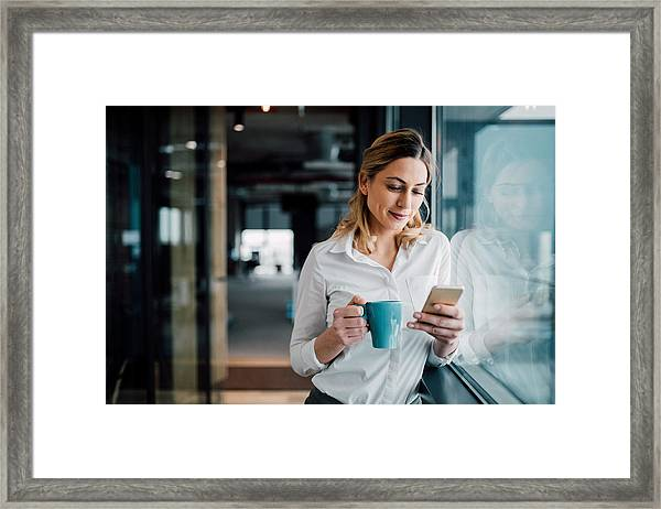 Professional Businesswoman Texting Framed Print by Filadendron