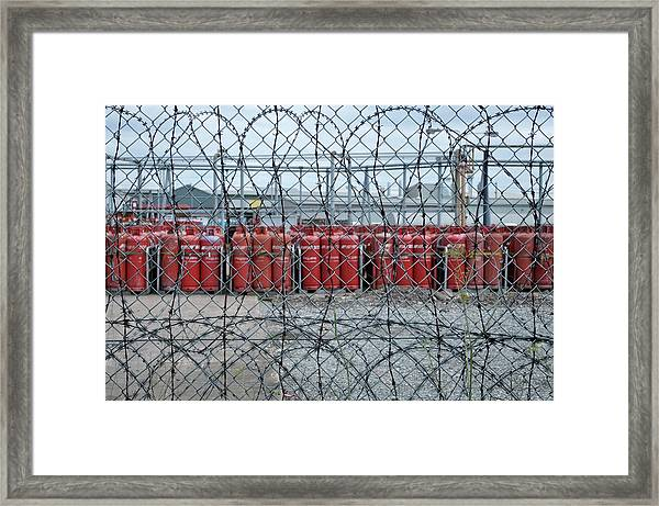 Propane Canisters In Secure Compound Framed Print