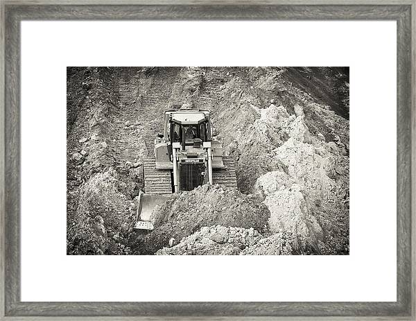 Pushing Dirt Framed Print