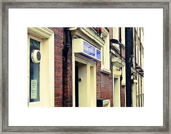 Queen's Stage Door Framed Print
