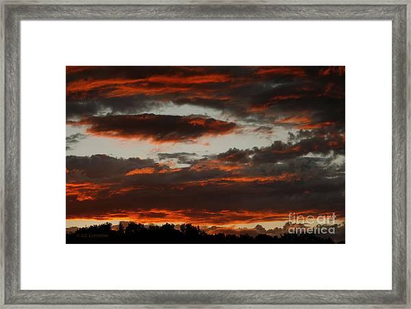 Raging Sunset Framed Print