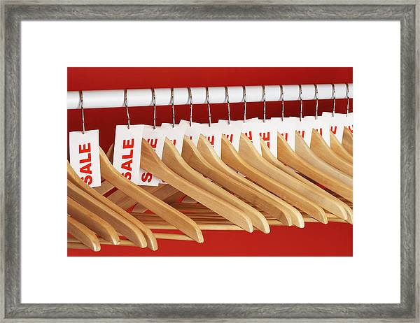Rail Of Clothes Hangers With Sale Tags Attached, Close-up Framed Print by Martin Poole