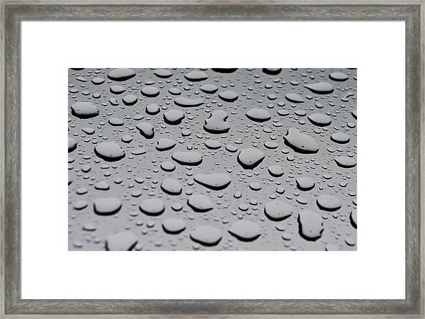 Rain On Sunroof Framed Print