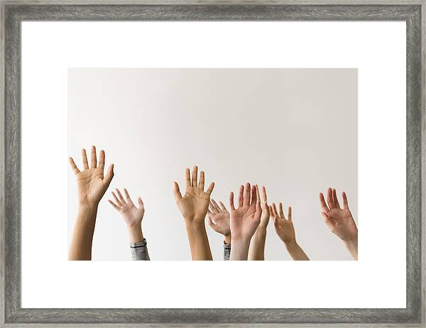 Raised Hands Of Women Framed Print by JGI/Jamie Grill