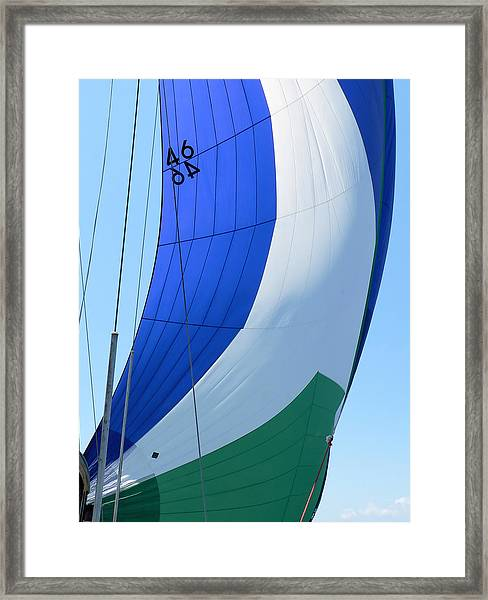 Raising The Blue And Green Sail Framed Print