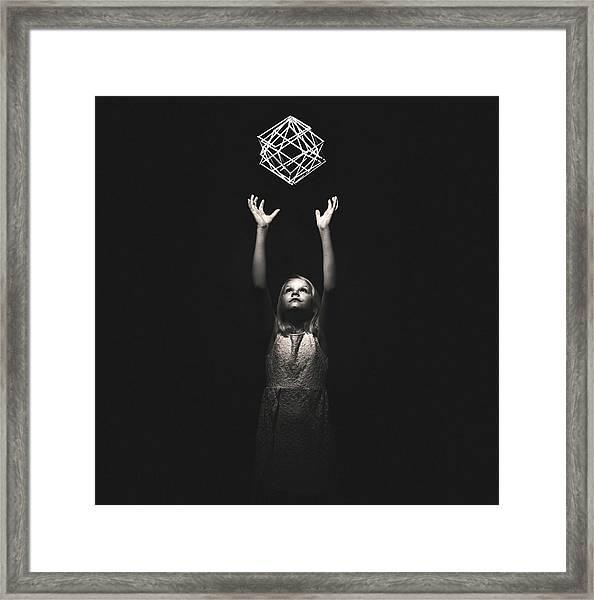 Reaching For A Dream Framed Print