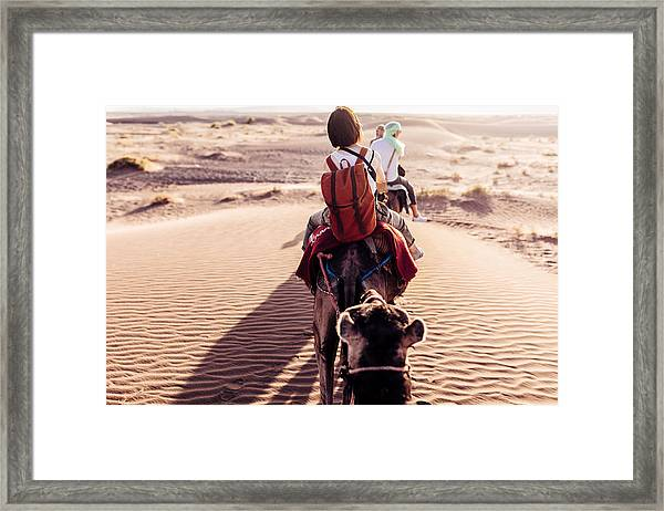 Rear View Of People Riding Camels In Desert Framed Print by Oscar Wong