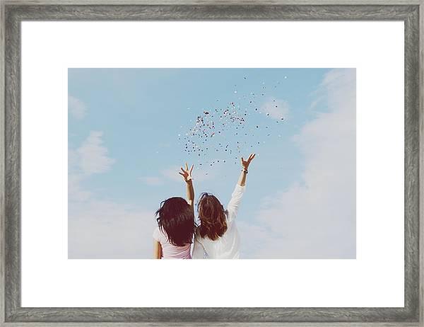 Rear View Of Women Throwing Confetti Framed Print by Raquel Perez Garrido / Eyeem