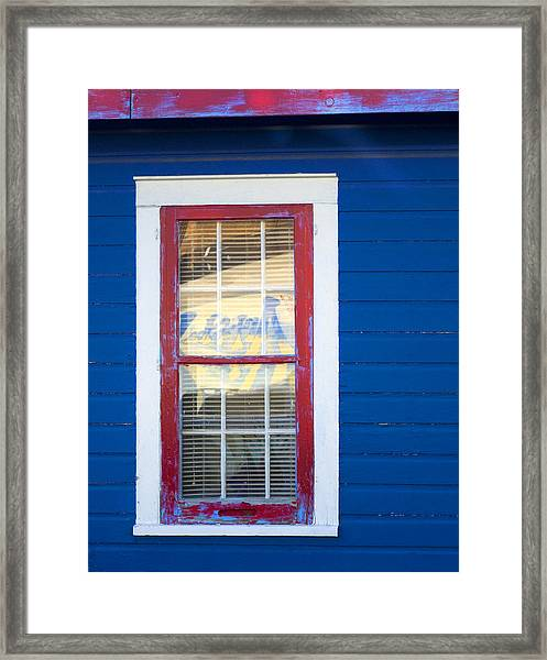 Red And White Window In Blue Wall Framed Print