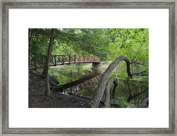 Red Bridge Over Peaceful Water Framed Print
