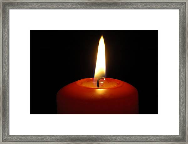 Red Candle Burning Framed Print