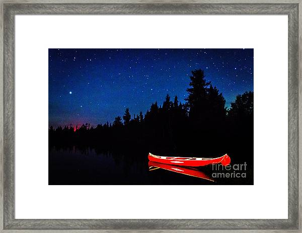 Red Canoe Framed Print