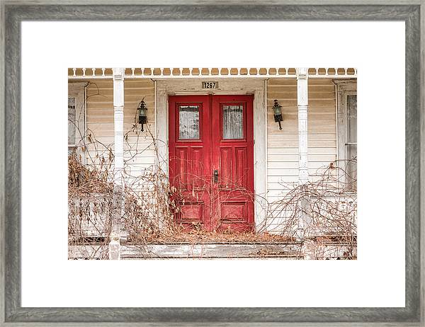 Red Doors - Charming Old Doors On The Abandoned House Framed Print