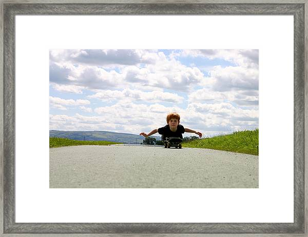 Red Headed Boy Skateboarding Framed Print by Image by Catherine MacBride