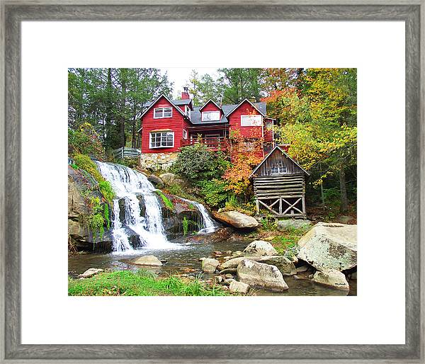 Red House By The Waterfall Framed Print