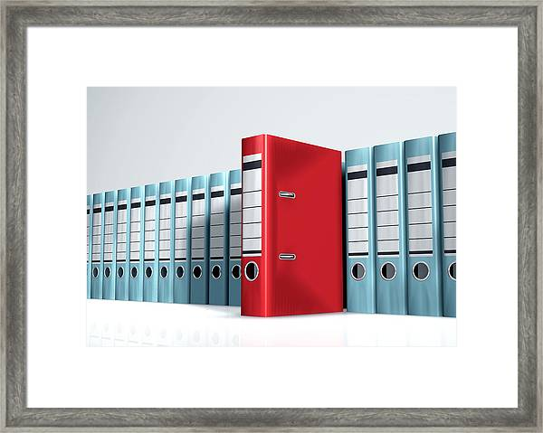 Red Lever Arch File In A Row Of Grey Files Framed Print by Artpartner-images