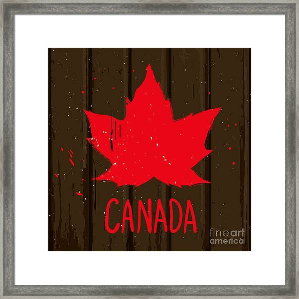 Red Maple Leaf On Brown Wood Wall Framed Print