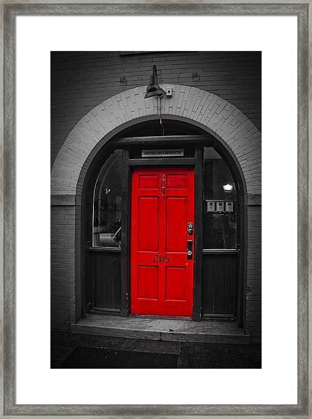 Behind The Red Door Framed Print