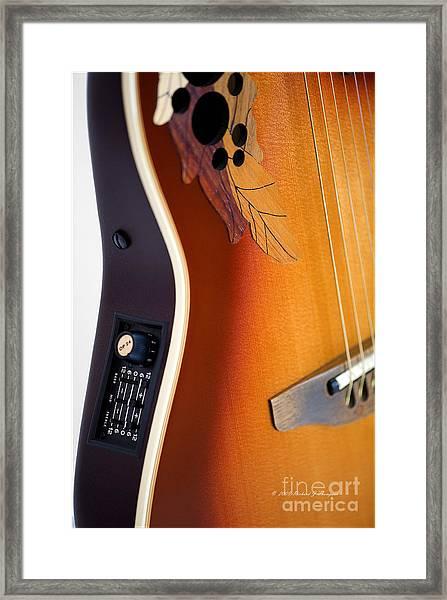 Redish-brown Guitar Framed Print
