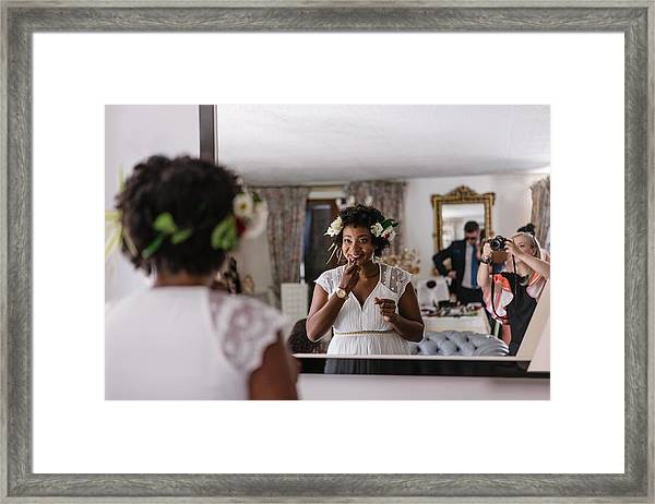 Reflection Of Bride Applying Lipstick While Standing In Front Of Mirror Framed Print by Adriana Duduleanu / EyeEm