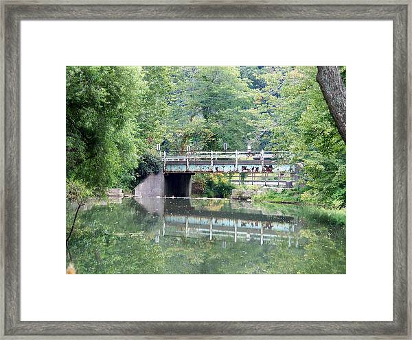 Reflections Of A Bridge Framed Print by Adam L