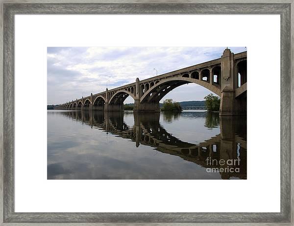 Reflections Of A Bridge Framed Print